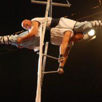 """7. Rippel Rekord-Kaqun  -2008. október 19.  Arénanap: Sportünnep, Papp László Budapest Sportaréna,20 méter magasban""""páros mellső mérleg tartás""""2 perc 39 másodpercig."""